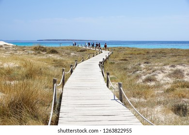 Wooden boardwalk and turquoise water at the Illetes beach in Formentera. Balearic Islands. Spain