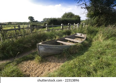a wooden boat in the countryside