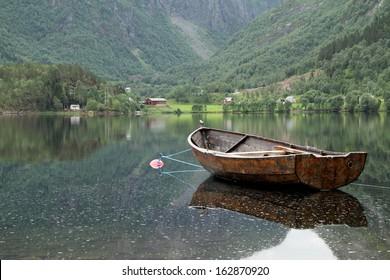 Wooden boat floating in a norwegian fiord