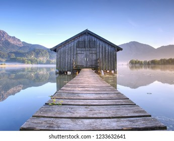 Wooden boat house.  Silent mountain lake and Boat shed