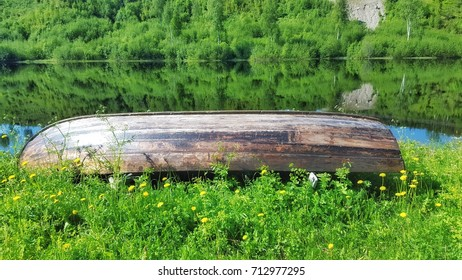 Wooden boat near the lake