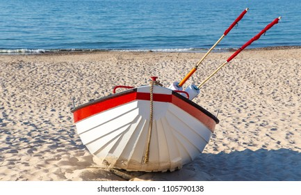 Wooden boat on the beach, Danish fishing boat on the beach