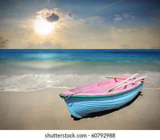 Wooden boat on a beach at sunset