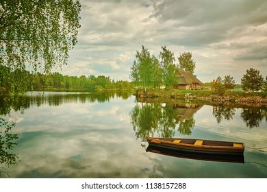 Wooden Boat on the River against Small Island with House