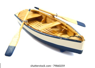 Wooden boat with paddles isolated over white