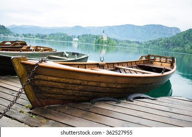 A wooden boat parked at the pier of Bled lake, Slovenia