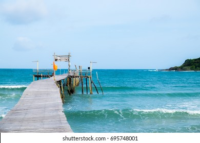 The wooden boat pier has wooden walkways stretching out to sea.