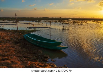 the wooden boat in sunset