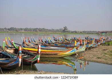 Wooden boat at U bein bridge in Mandalay, Myanmar