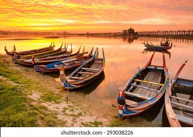 Wooden boat in Ubein Bridge at sunrise, Mandalay, Myanmar (World longest wooden bridge)