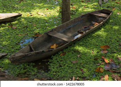 Wooden boat in the village San Antonio de Cacao at Amazonas river in Peru