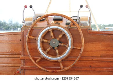 Wooden boat wheel and console