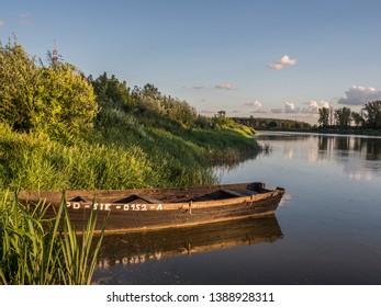 Wooden boats at the bank of the Bug River.  Drohiczyn. Podlasie. Podlachia. Poland, Europe. The region is called Podlasko or Podlasze