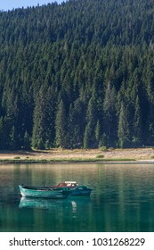 wooden boats at the Black Lake pier in the Durmitor National Park. Montenegro.