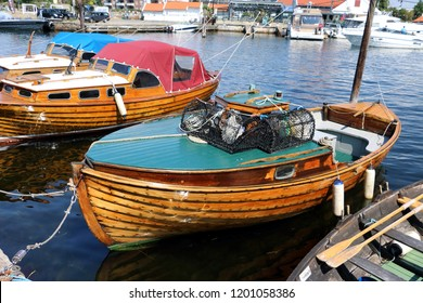 wooden boats in harbor Kristiansand Norway