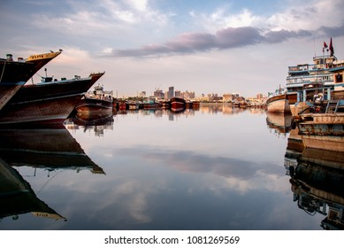 Wooden boats moored at creek harbour in Dubai