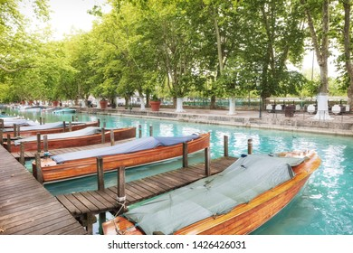 Wooden boats moored on of Thiou river canal in Annecy, France