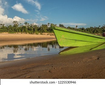 Wooden boats on the sandy beach at the Javari River, the tributary of the Amazon River, during the low water season. Amazonia. Selva on the border of Brazil and Peru. South America. Dos Fronteras.
