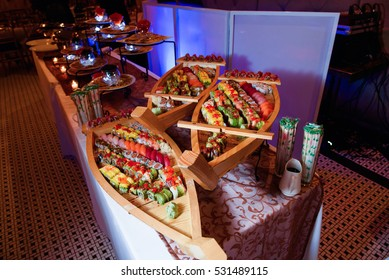 Wooden boats served with sushi