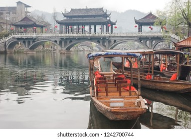 Wooden boats in Tuojiang River (Tuo Jiang River) in Fenghuang old city (Phoenix Ancient Town),Hunan Province, China.