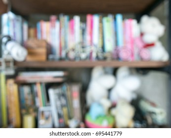Wooden bookshelf with decoration of dolls and toys