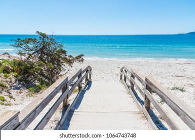 Wooden bordwalk in Maria Pia beach. Alghero, Sardinia