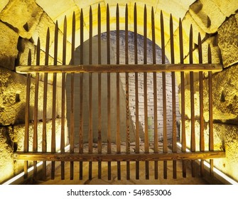 Wooden boundary fence or gate in stone cave