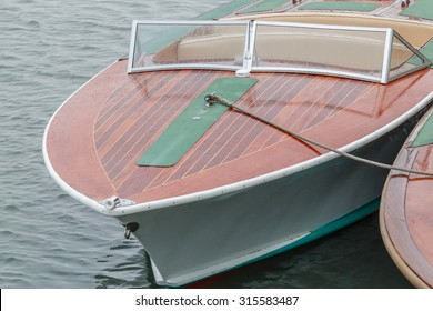 Wooden bow decks of a traditionally built power boat or speedboat. The deck is made of mahogany planks.