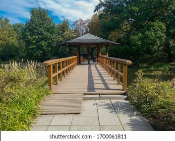 Wooden bower with wooden bridge in japanese garden