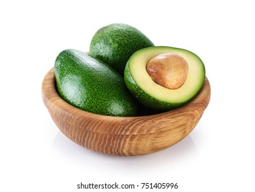 Wooden bowl with avocado isolated on white background. With clipping path.