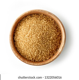 wooden bowl of brown sugar isolated on white background, top view