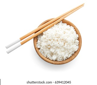 Wooden bowl with coconut rice on white background