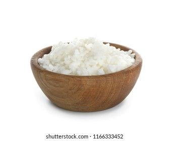 Wooden bowl with freshly cooked rice on white background