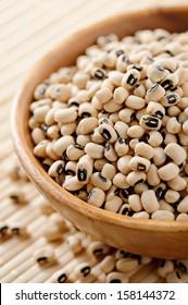 Wooden bowl full of black-eyed peas