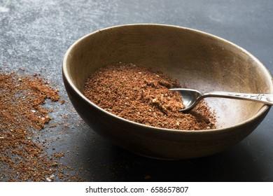 Wooden bowl with homemade taco season