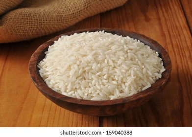 A wooden bowl of long grain white rice