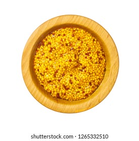 Wooden bowl with mustard sauce, wholegrain mustard isolated on white background