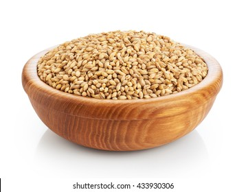 Wooden bowl with pearl barley isolated on white background. Close-up.