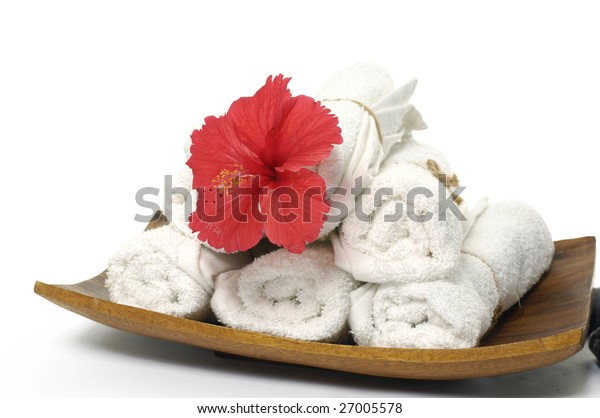 Wooden bowl with red flower and towel
