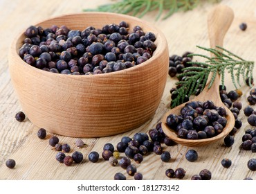 Wooden bowl with seeds of juniper. Selective focus