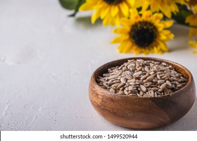 Wooden bowl of sunflower seeds with copy space