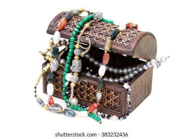 Wooden box with beads and necklaces of semi-precious stones inside