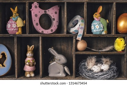 Wooden box with cells filled with Easter decor.