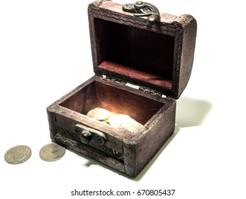 Wooden box with coins pattern