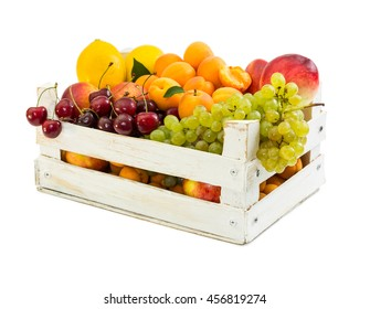 Wooden box with different fruits isolated on white background