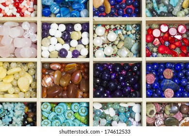 Wooden box with different gemstones