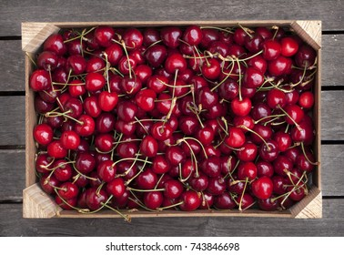 Wooden box of fresh cherries
