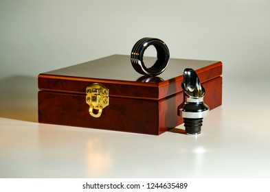 Wooden box with a gold lock for a set of wine