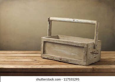 Wooden box on wooden table over grunge background