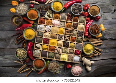 Wooden box with spices and herbs